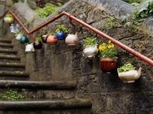 arte callejero macetas y flores